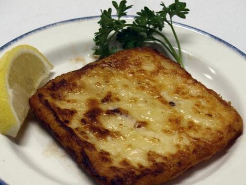 Athens Saganaki is breaded Greek cheese flambeed with Metaxa brandy